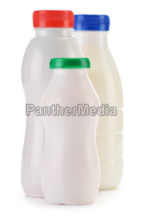 composition with plastic bottles of milk