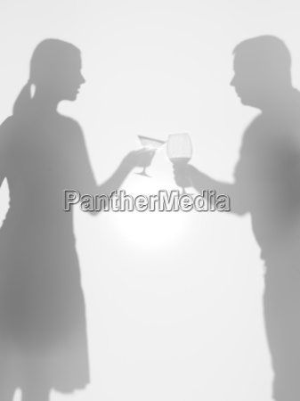 people olding glasses silhouettes cheers