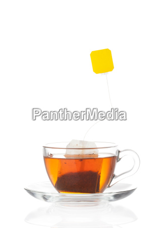 hot tea in transparent glass cup
