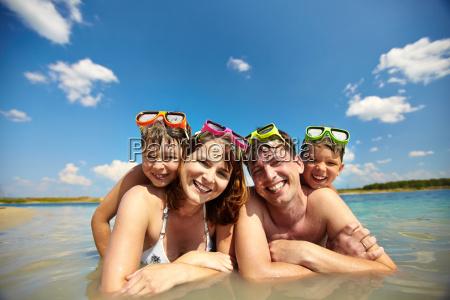 sunbathers in water