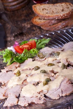 vitello tonnato on a glass plate