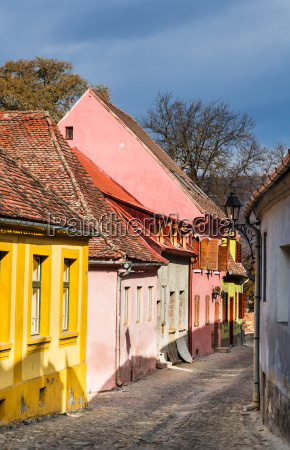 medieval paved street in sighisoara transylvania