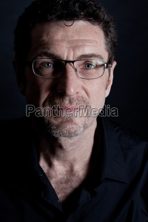 adult confident man with glasses