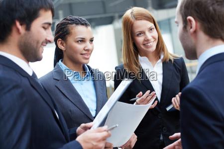 talking at meeting