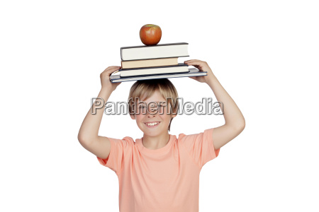 smiling boy with books and a