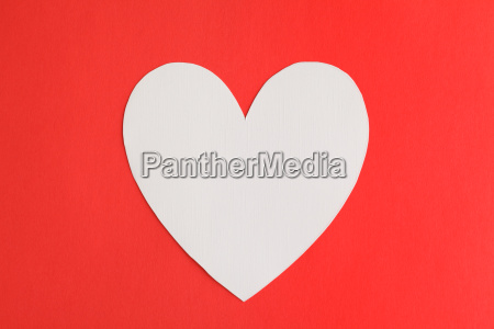 heart shape paper over red paper