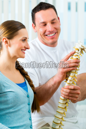 consulting patient in physiotherapy