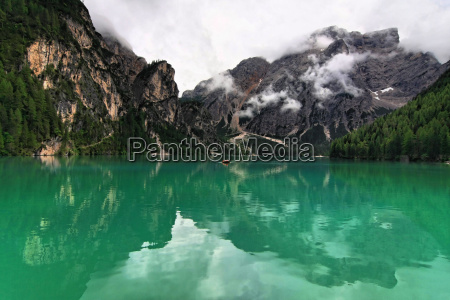 mountains green dolomites alps mirroring rowing