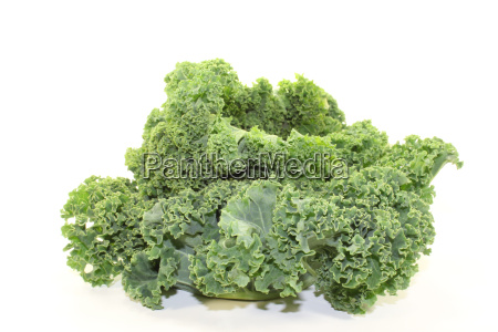 kale in front of light background