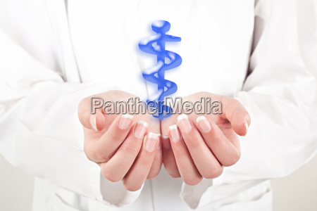doctor woman holding health symbol in