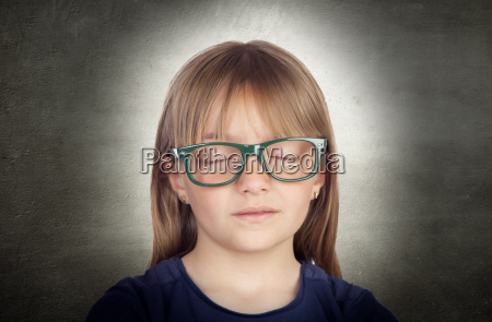 beautiful little girl with glasses and