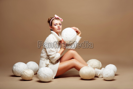 knitting sewing woman in white knitted