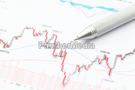 business financial chart with pen