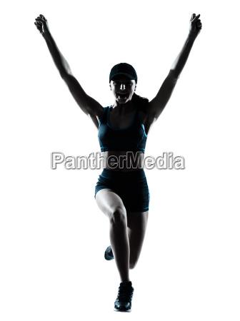 woman runner jogger jumping happy