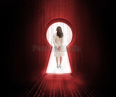 businesswoman standing in the keyhole doorway
