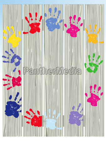 childrens handprints on fence