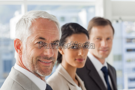 smiling business people looking in the