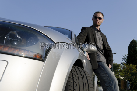 successful businessman in front of his