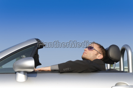 successful businessman in a convertible relaxet
