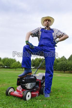 gardening man mowing the lawn
