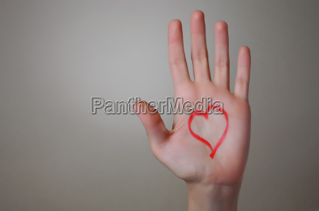red heart shape on a hand