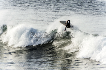 surfer riding a big wave