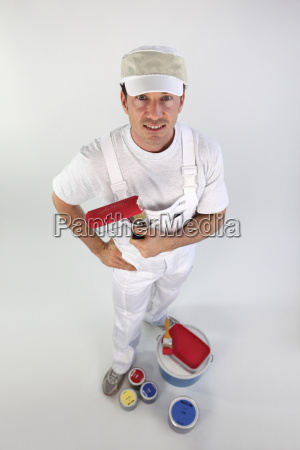 decorator holding a paint roller