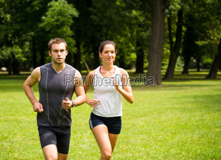 jogging together young couple running