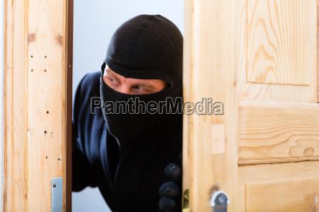 burglar offender opens a door