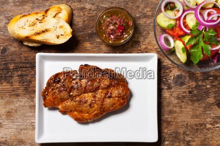pork steak with chimichurri sauce