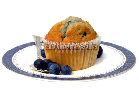 blueberry muffin on a china plate