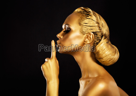 secrecy bodyart golden woman showing silence
