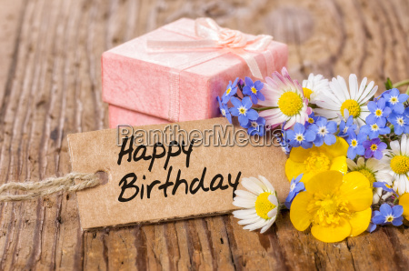 birthday gift with flowers and card