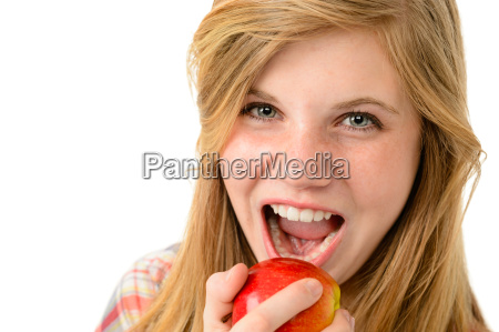 teenage girl eating healthy apple