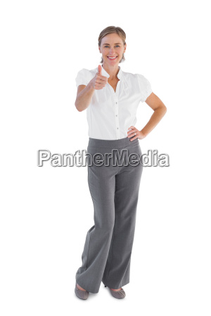 smiling businesswoman showing her thumb up