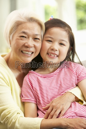 chinese grandmother and granddaughter relaxing on