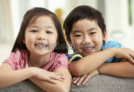 two chinese children relaxing on