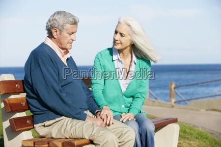 senior, woman, comforting, depressed, husband, sitting - 9340016