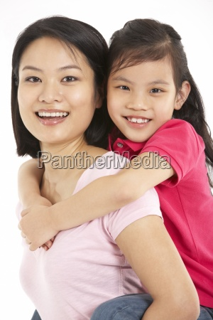 studio shot of chinese mother and