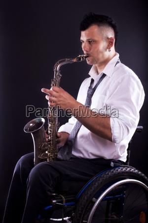 wheelchairs playing saxophone