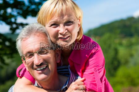 happy elderly couple walking