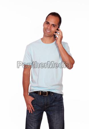latin adult man speaking on cellphone