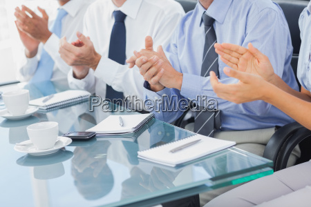 group of business people applauding in
