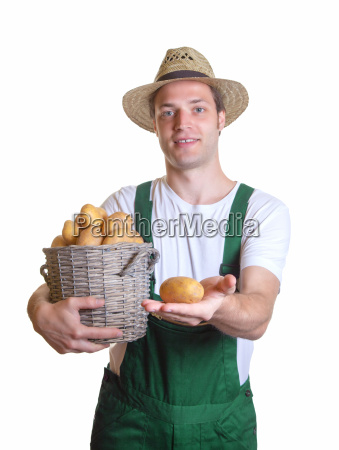 friendly gardener showing his potato