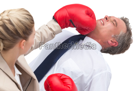 a businesswoman boxing her co worker