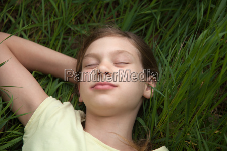 girl relaxing on a meadow in