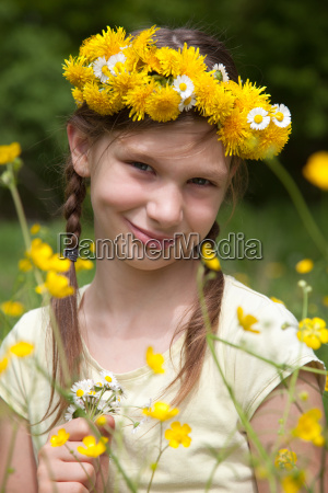 girl with flowers in nature