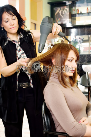 dries hair in salon