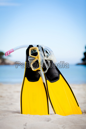 yellow diving fins and snorkel mask