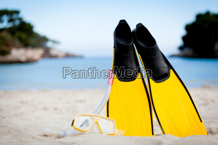 yellow diver fins and snorkel mask